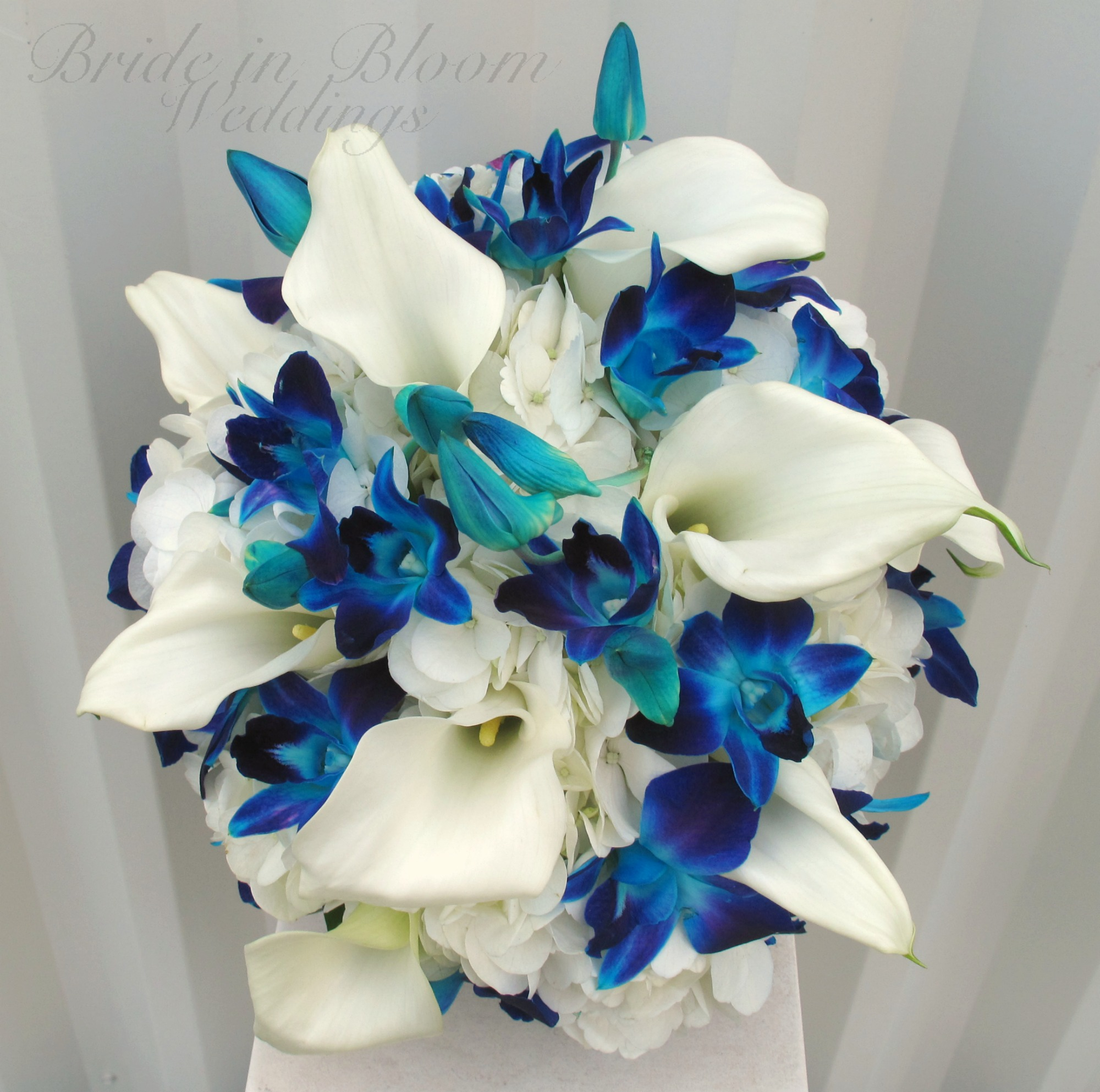 Blue orchid white calla wedding bouquet