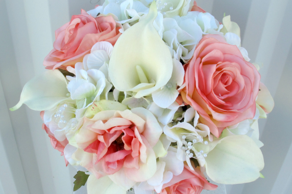 Coral rose calla lily wedding bouquet