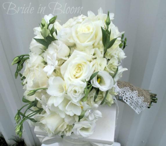 all_white_wedding_bouquet_with_raffia_1.jpg