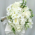 all_white_wedding_bouquet_with_raffia_1.png