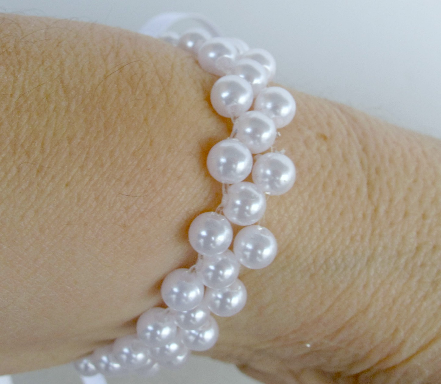 how to make a wrist corsage on a pearl bracelet