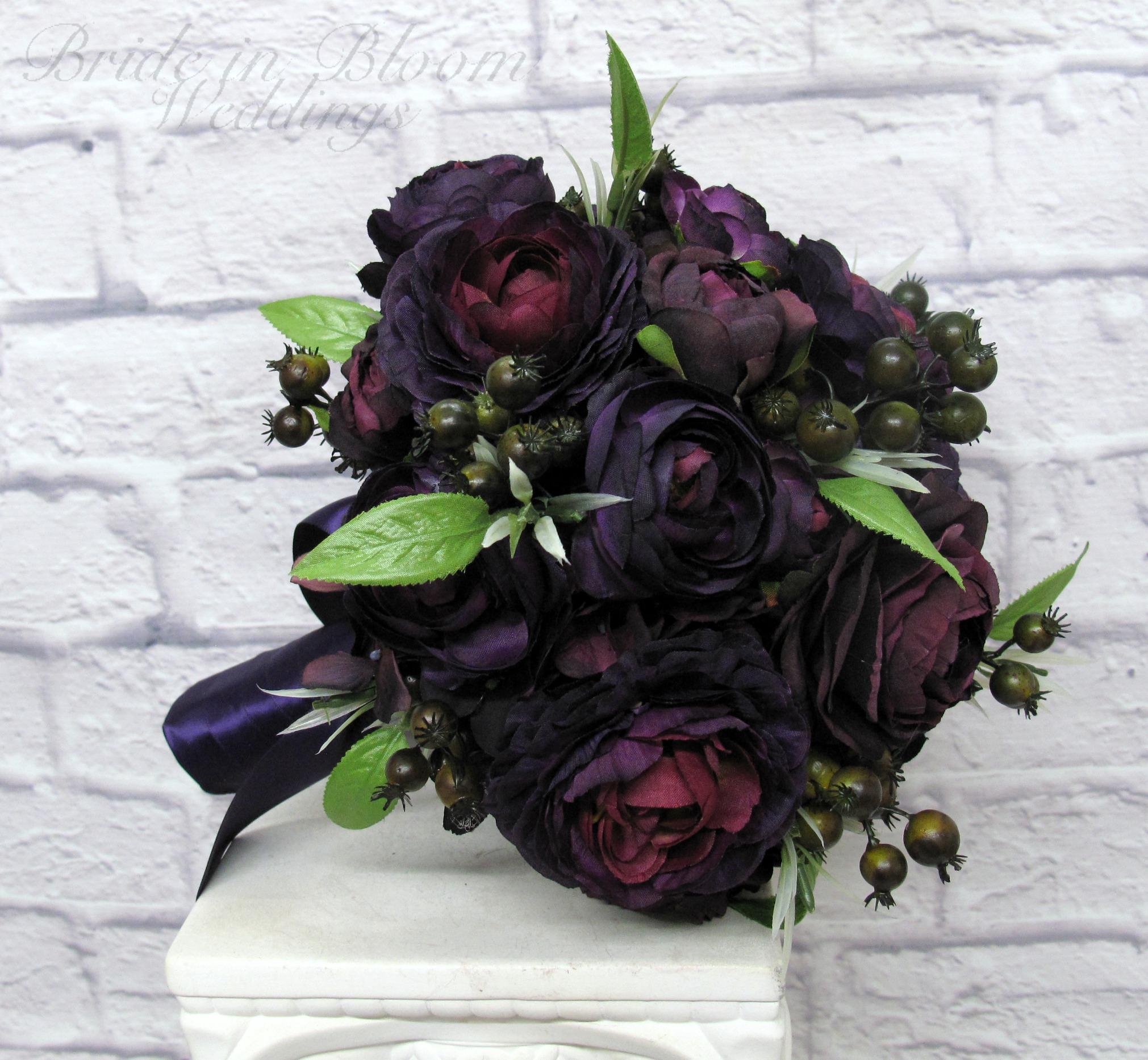 Purple ranunculus wedding bouquet bride in bloom