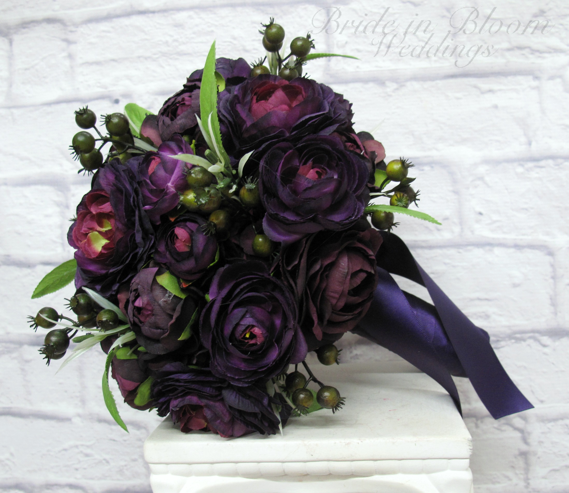 Purple ranunculus wedding bouquet bride in bloom